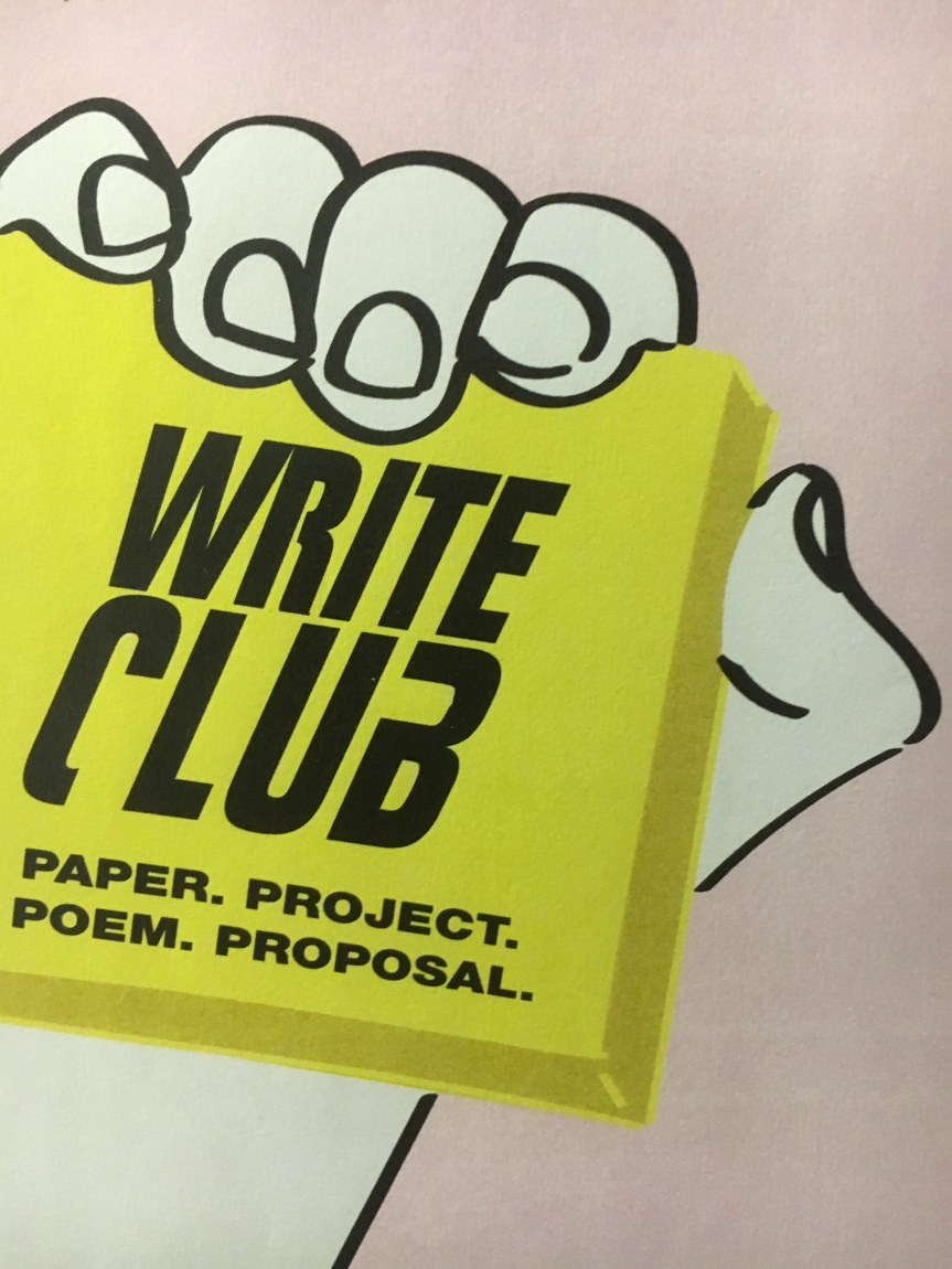 fist holding yellow post it with the words 'Write Club Paper.Project.Poem. Proposal.